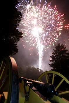 A 1781 Yorktown canon used in the Revolutionary War and the War of 1812, owned by Roger Stark of Louisville, is lit by fireworks following the concert by The United States Army Field Band at the McKinley National Memorial. This and other canons were fired during the 1812 Overture.