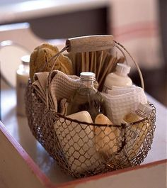 Panier savons... wire basket of bath supplies like soaps and towels... inspires me for the laundry room, too