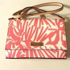 Kate Spade Peony Palm print crossybody bag  Kate Spade fuchsia and white printed bag with cream strap. Excellent condition. Like New with tags removed. Peony Palm print. Perfect size for vacation or summer bag  kate spade Bags Crossbody Bags