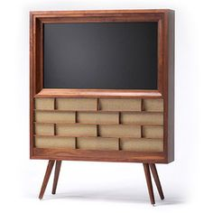 Such a cool way to work a flat screen into retro mod decor.