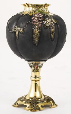 A Japanese Export silver-gilt, metal and enamel goblet, circa 1880 patinated gourd-form applied with enameled wisteria, the base with cloisonné enameled foliage marked on base with maker's mark of turtle in triangle