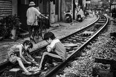 In Hanoi, the land price is so high that people have to live literally by the railway. Thus, the railway becomes the playground for Hanoian children.