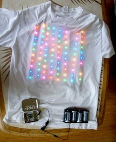 Jerry's LED T-Shirt! I wore this LED T-Shirt under nice white shirt to teach the class at Hawaii STEM Conference. It is an array of individually addressable LEDs strip from… Smart Textiles, E Textiles, Led Projects, Arduino Projects, Light Up Clothes, Deco Led, Led Costume, Wearable Technology, Medical Technology