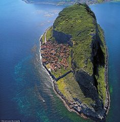 Hidden behind a rock! This tiny settlement is concealed from the Greek coastline behind a ...