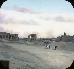Egypt: Thebes~Lantern Slide Collection: Views, Objects: Egypt. Thebes [selected images]. View 02: The  Ramesseum, general view. Thebes. 19 Dyn. Tomb Temple of Ramses, West  of Thebes., n.d., This slide colored by Joseph Hawkes. Brooklyn Museum  Archives (S10|08 Thebes, image 9867).