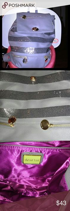 """💕PRICE⬇Gorgeous Full Size Non Leather Backpack💕 Great preowned condition. Grey with sequins strips exterior,  fuschia interior with a drawstring & turnlock closure. Never carried it but there's a few small scratches on the gold tone zipper pulls. Clean interior see pics #3-4. Great backpack PVC not leather! No dust bag/cover with your purchase. Thank you for your interest😃  Apprx 15"""" H x 16"""" W x 6.5"""" D. ****📷 MALFUNCTION NO DISCOLORATION TO BAG**** Deux Lux Bags Backpacks"""