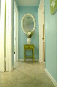 mirror at the end of hallway with little refinished table and a plant or other decor...  Would have to find a way to fasten table to wall so that the babies don't pull it over