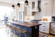 Open doors light up this contemporary kitchen with eclectic details