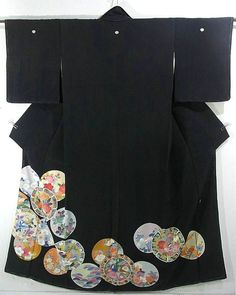 This is a Kurotomesode Kimono with a design of 'oshidori'(mandurin duck) and seasonal flowers on plate, which is dyed