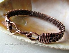 This copper bracelet features 4 wires which have been intricately woven together to form a beautiful pattern. It is both elegant and rustic in design that looks great on both men and women. Wire Wrapped Bracelet, Woven Bracelets, Copper Bracelet, Copper Jewelry, Bracelets For Men, Wire Jewelry, Copper Wire, Handmade Jewelry, Bracelet Men