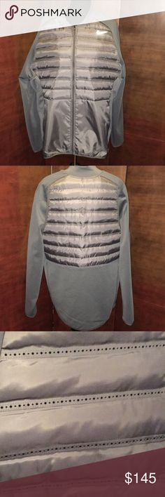 NWT Nike Gray Sports Jacket w/ Vents & Earbud Hole NWT Nike Gray Sports Jacket w/ Vents & Earbud Hole. This jacket is designed for breathability with air holes on front and back. It has holes for earbud management. Measures approx 29 inches long and 27 inches across on a flat lay. Checkout my other jackets. Add to a bundle and save! Nike Jackets & Coats Performance Jackets