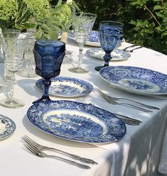Rent your china and colored goblets! In this photo we used our Blue and White Dinner plates, mismatched stainless steel flatware and our navy blue water goblets against a white linen and white napkin. We deliver to the Chicagoland and Lake Geneva area. White Table Settings, Beautiful Table Settings, Christmas Table Settings, Blue And White China, Blue China, Navy Blue, Dining Room Table Decor, Dining Rooms, White Dinner Plates