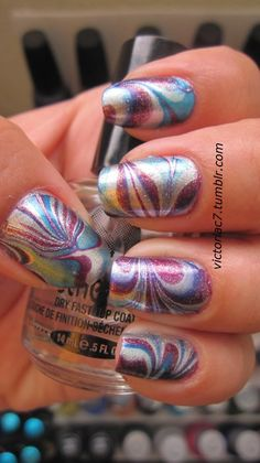 I keep getting told that you cant use shimmer polish to do water marble nails but this is proof that you can. Love these colors together and love how shiny they are.