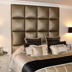 individually padded and covered squares attached to form a headboard