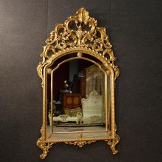 Great Italian mirror of the mid-20th century. Furniture in Louis XV style in richly carved and golden wood of fabulous decoration and excellent quality. Mirror of large measure and impact constructed in