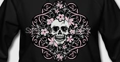 Girly skull with delicate pink flowers and ribbons on a black background.