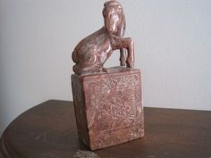 Horse carved soapstone  brown tones with detail carving on base signed on bottom