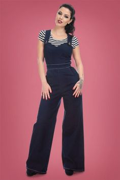 These 50s Karla Heart Dungarees in Navy are super comfy and stylish!Loving your favourite jeans but looking for something different? Then we have the perfect solution for you! This beauty combines the perfect high waist style with the details of a dungaree, we love it. The shoulder straps can be worn playfully crossed at the back. Made from a stunning denim cotton blend with a light stretch and contrasting white seaming for that true vintage look. Roll up the legs for an extra sturdy...