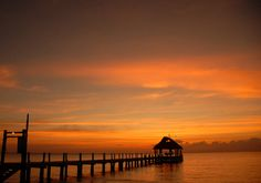 Enjoy stunning sunsets on the private pier at Secrets Aura Cozumel.