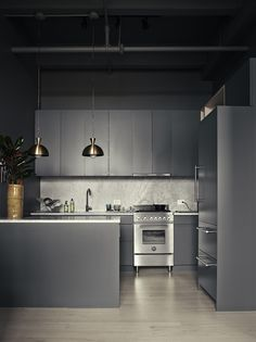 Bangia Agostinho Architecture fitted photographer Pia Ulin's Brooklyn kitchen with Ikea Sektion cabinets and custom fronts painted with Farrow & Ball Down Pipe for an unbroken, consistent look. SeeLight and Shadow: Photographer Pia Ulin at Home in Brooklyn for more.