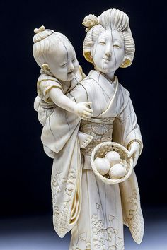 JAPANESE CARVED IVORY OKIMONO OF A MOTHER AND CHILD, MEIJI PERIOD (1868-1912) Signed.  Dimensions: Height 6 in. (15.2 cm.), Width 2 1/4 in. (5.7 cm.), Depth 2 1/4 in. (5.7 cm.)