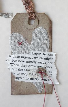 Began to kiss ~ mixed media art tag for Valentine's day by Carolyn Saxby. Love the idea of using a bit from a romance novel!