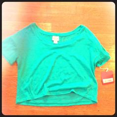 NWT Diamond Patterned Turquoise Crop Top Has a faint diamond pattern. Never worn- NWT Tops Crop Tops