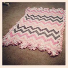 crochet chevron baby blanket with double ruffle around the edge.