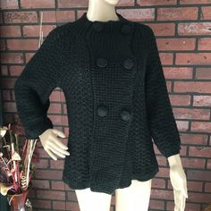 Anthropologie chunky double breasted sweater L Nubby from Anthroplogie. Great chunky sweater that has 3/4 sleeves that are a bit wider. Buttons are oversized and covered in same black material. This is so adorable but haven't worn in a while so time to find a new home! No stains or wear noted, great pre-loved condition. 70% acrylic, 30% wool. I liked to wear this with a white button down sleeve top and great jeans ( skinny cropped or boyfriend/slight straight), great heels or knee high…