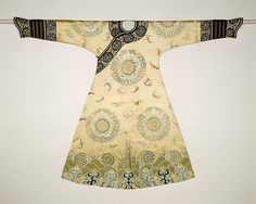 Woman's Ceremonial Robe (The Bat Medallion Robe) Period: Qing dynasty (1644–1911) Date: first half of the18th century Culture: China Medium: Silk and metallic thread embroidery on silk satin Dimensions: 54 x 75 in. (137.2 x 190.5 cm) Classification: Costumes-Embroidered Credit Line: Anonymous Gift, 1943 Accession Number: 43.119