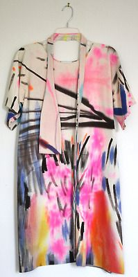 hang white fabric next to easel.  and you know, dry brushes on it.  then make a dress.