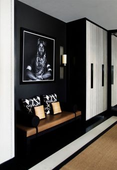 Decorative Accents 69070 a black and white entrance hall with chic ethnic decor accents with a beautiful leather seat next to the cupboard, black and white hallway decoration House Design, Furniture Market, Interior, Home, Hall Decor, House Interior, Entrance Hall Decor, Interior Design, Hygee Home