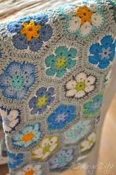 African Flower crochet blanket - love the colors