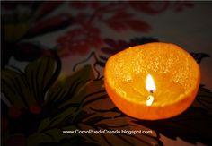 Una vela hecha con una cáscara de mandarina.  A candle made with tangerine peel