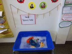 Washing doll clothes in our sensory bin and hang drying them on our clothes line for Mrs. McNosh Hangs Up Her Wash.