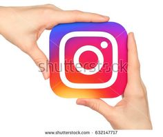 Kiev, Ukraine - January 20, 2016: Hands hold Instagram icon printed on paper. Instagram is an online mobile photo-sharing, video-sharing service.