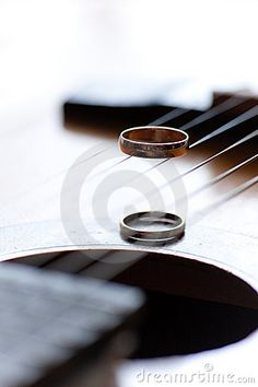 Two wedding rings are on guitar stripes by Marina Fadeeva, via Dreamstime