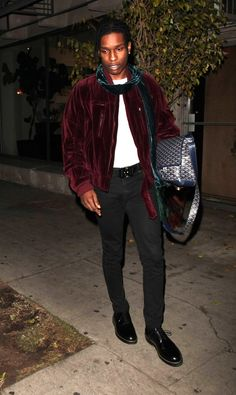"A$AP Rocky makes a fashion statement with his ""murse."" Rocky has always been in the spotlight for his classic style and now he is making a statement for all men. He also flaunts his style with a nice bomber jacket and scarf. -Shemaia F."