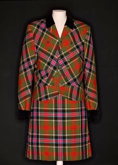 Man's woollen kilt suit in Bruce of Kinnaird tartan manufactured by Lochcarron of Scotland, Galashiels, part of the Anglomania collection designed by Vivienne Westwood, London, autumn/winter 1993/1994.