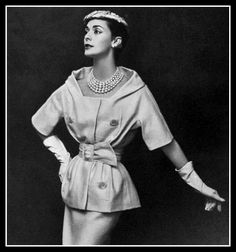 Kouka Denis in natural silk shantung two-piece, top is roomy with wide neckline and tightly cinched with same-fabric belt, by Christian Dior, photo by Georges Saad, 1957