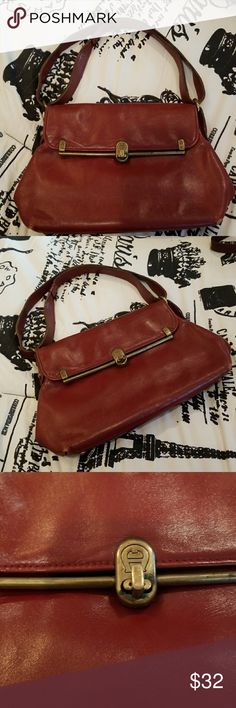 50% OFFVINTAGE AIGNER 50% OFF BUNDLES of 2+ Burgundy/ Rust color with bronze accents. Just dry cleaned and in good condition for a vintage bag. Small wear on corners and inside lining is coming loose at parts. Strap can be worn short or long.  Why SHOP MY Closet? Most NWT or Worn Once Smoke/ Pet Free OVER 450 RATINGS & RISING! TOP 10% Seller  TOP RATED  FAST SHIPPER  BUNDLE DISCOUNT OF 20% VIP REWARDS w/ EACH PURCHASE  QUESTIONS?? PLEASE ASK! ❤HAPPY POSHING!!!  Etienne Aigner Bags