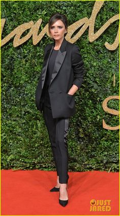 Victoria Beckham in a suit from her own line.