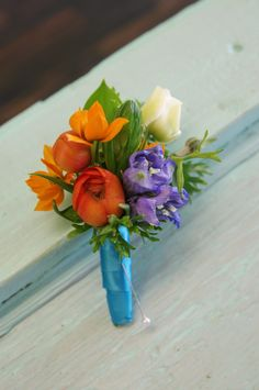And the boutonniere to match the corsage with the awesome complementary colors. :)