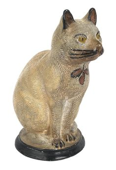 Pennsylvania chalkware cat, 19th c., with a polychrome decorated surface, 13'' h.