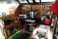 That's my kinda camp kitchen....complete with a bottle of liquor in the pull-out piece!