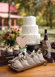 Table decor at a rustic wedding. Rustic favor bags