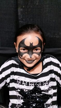 Who says girls can't get a batman mask?  Beautiful batgirl!
