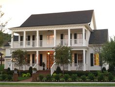 Love White Farmhouses With Dark Shutters U0026 Red Doors. The Verandas On This  House Are Beautiful