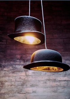 This is pretty much the coolest light idea ever.  I wish I had somewhere in my home to hang a few of these.  The bowler hat table lamp is amazing, too!
