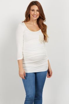 Your perfect fitted maternity top for this season. With its unique fitted silhouette, this top will flatter your baby bump throughout your transitions in pregnancy. Style this top with your favorite maternity jeans and flats for a complete casual day look.